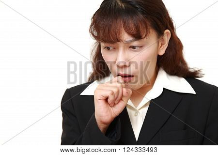 portrait of Asian businesswoman coughing on white background