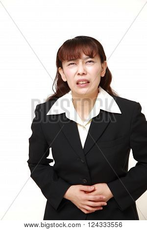portrait of Asian businesswoman suffers from stomachache