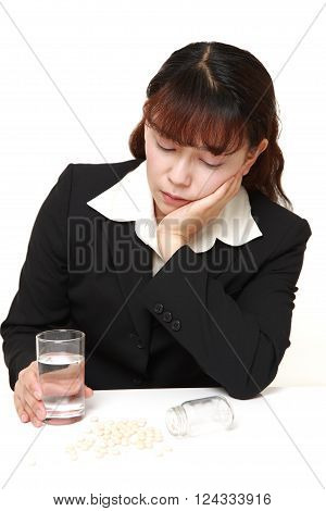 portrait of Asian businesswoman suffers from melancholy