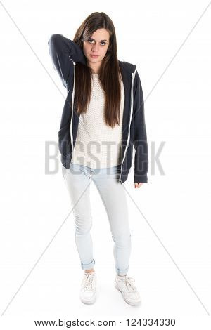 Full lenght portrait of a young caucasian teen looking to the camera on white.