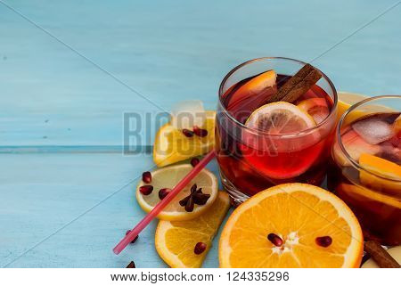 summer cocktail sangria with fruit in a basket. oranges, lemons, cinnamon