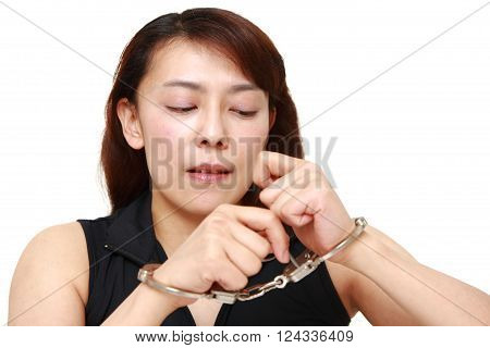 Woman trying to free herself on white background