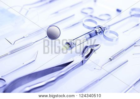 Professional dental tools in a sterile medical light