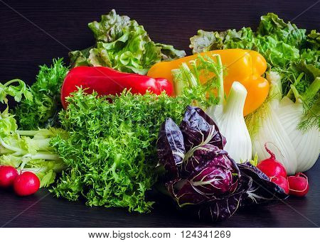 Different raw vegetables background. Healthy eating. Colorful vegetables background. Healthy food background. Different vegetables on wooden table.
