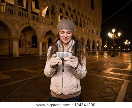 Smiling Woman Tourist Writing Sms On St. Mark's Square, Venice