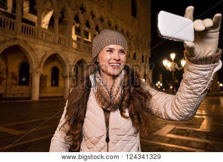 Smiling Woman Tourist Taking Photos On St. Mark's Square, Venice
