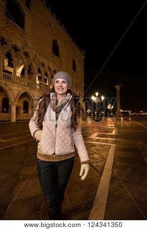 Happy Young Woman Walking Near Dogi Palace St. In Venice