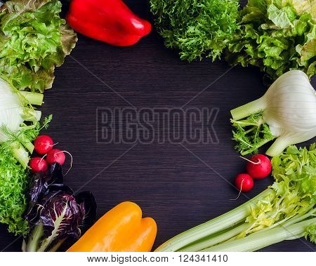 Different raw vegetables in a circle with empty place for text inside. Healthy eating. Colorful vegetables background. Healthy food background. Copy space. Top view. Food flat lay.