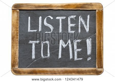 listen to me exclamation handwritten on vintage school slate board isolated on white
