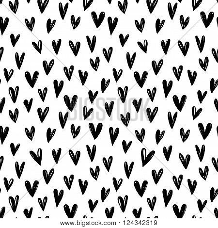 Seamless pattern with hand drawn hearts. Ink illustration. Graphic hearts. Abstract ink illustration. Hand drawn ornament for wrapping paper and posters.