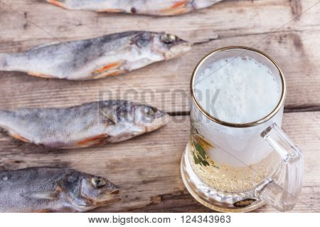 mug of beer and dried fish on the table top view