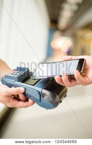 Woman pay by NFC technology