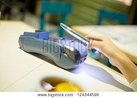 Woman pay the bill inside restaurant