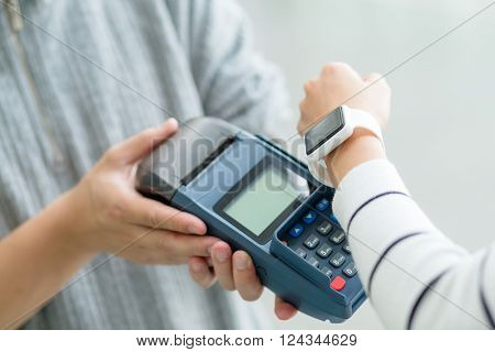 Woman using smart watch to pay
