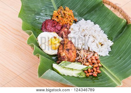 Traditional Nasi Lemak Cuisine On Banana Leaf With Fried Chicken