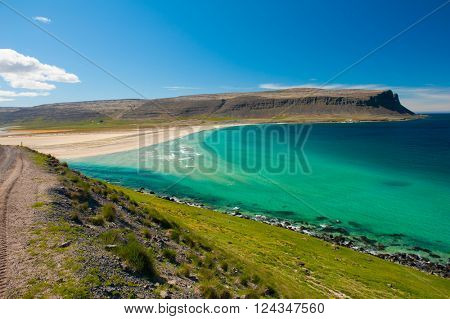 Extremely beautiful bay with mighty golden beaches and turquoise sea in the West Fjords, Iceland.