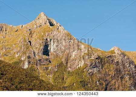 Mountain peak on a  clear sunny day in Fjordland New Zealand