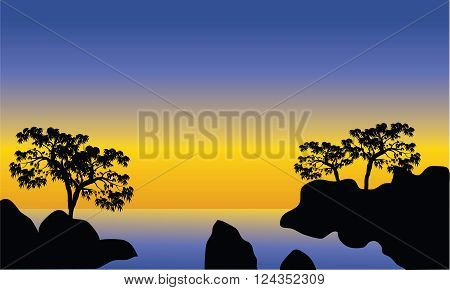 Silhouette of sea and rock at the afternoon