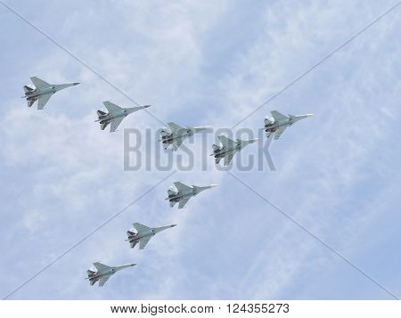 Moscow-May 9 2015: Eight multi-purpose heavy fighter gray-blue Su-30 is flying high in the sky at the Victory Day parade May 9 2015 Moscow Russia