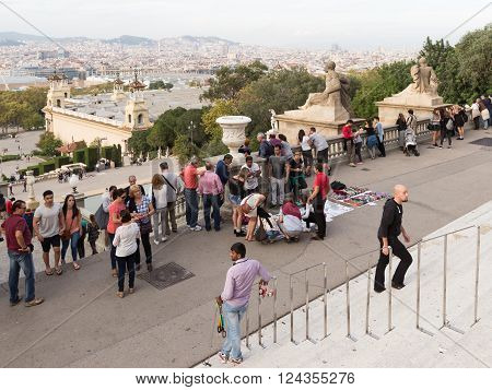 Barcelona - 10 October 2015: View of the city of Barcelona with the Montjuic hill and people walk in front of the Museum of Catalonia. October 10 2015 Barcelona Catalonia Spain