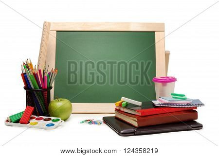Group of school and office supplies with chalkboard watercolor paints, stack of colored pencils and markers, isolated on white