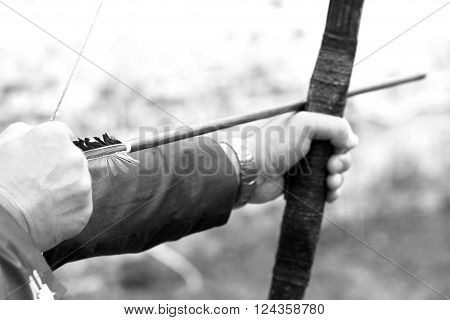 Archer holds his bow, black and white photo