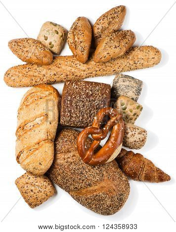 Top view of group of baked goods from a bakery made from whole wheat and grains with breads as pumpernickel isolated on white background.
