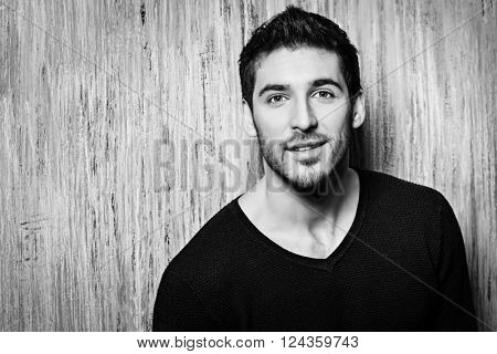 Casual young man looking at camera and smiling. Men's beauty.