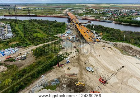 Tyumen, Russia - August 29, 2015: Construction of East Round bridge through Tura River