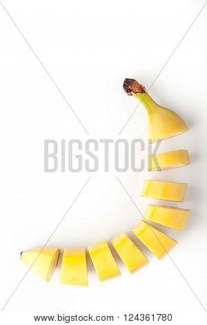 Sliced banana on the white background vertical
