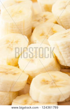 Banana slices background vertical pattern, design, close-up