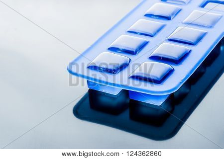 Ice cube tray with ice horizontal background