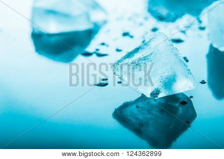 Ice cube in the blue background horizontal