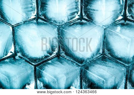 Honeycomb ice cubes background top view horizontal