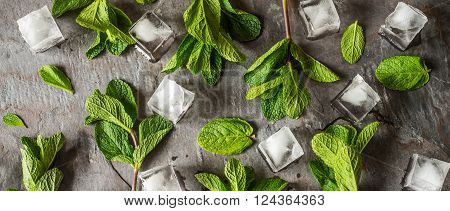 Fresh mint with ice cube on the stone table wide screen