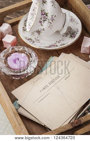 Tea things with sweets on the wooden tray vertical