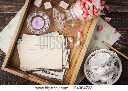 Tea things with sweets  on the wooden tray top view