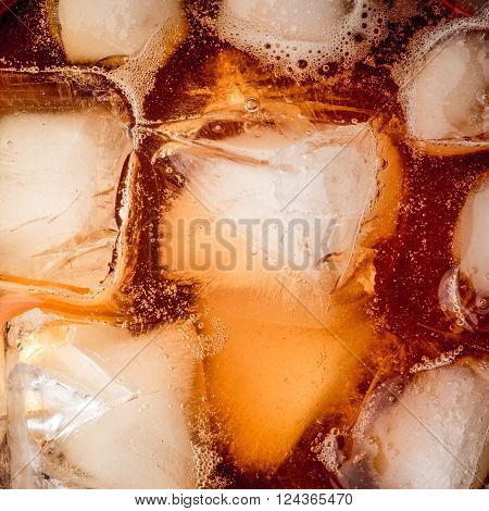 Rum with ice background square horizontal brown