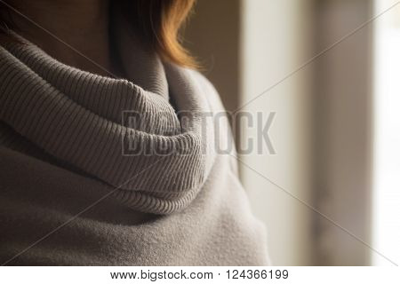 Woman in the gray sweater background horizontal