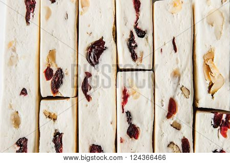 Nougat with fruit and nuts background horizontal