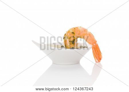 Delicious shrimp eating. Dripping cooked prawn into delicious sauce. Culinary and gourmet eating.
