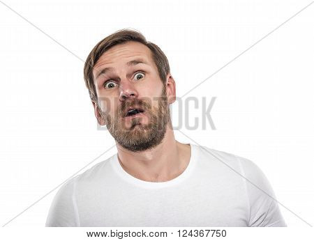 Portrait of young man surprised isolated on a white background