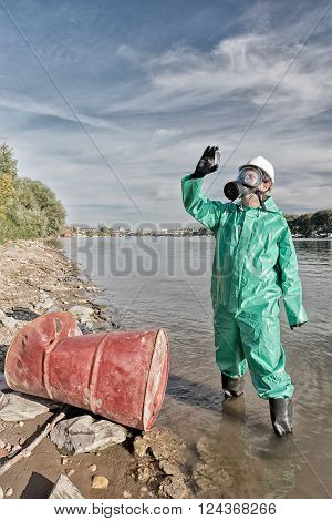 Environmentalist examining collected sample of polluted water