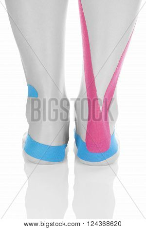 Therapeutic tape on female foot isolated on white background. Chronic pain alternative medicine. Rehabilitation and physiotherapy.