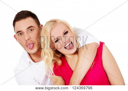 Funny love couple making stupid faces