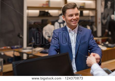 Young businessman at checkout