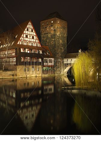 Nuremberg Germany - March 21 2016: The wine depot in the old town of Nuremberg besides the Pegnitz river at night
