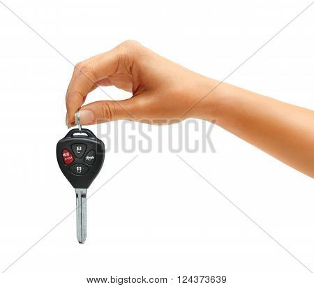 Woman's hand holding car keys isolated on white background. Close up