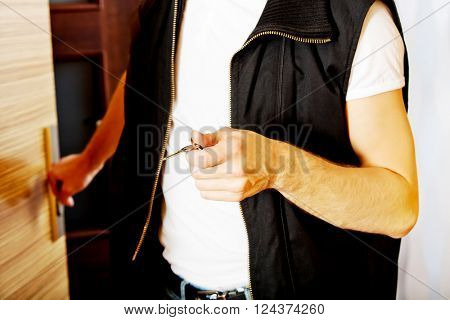 Young man returning or going out from home