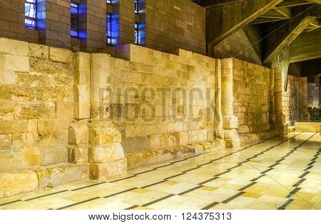 The ruined walls of medieval churches are located in the lower level of the Basilica of Annunciation in Nazareth Israel.